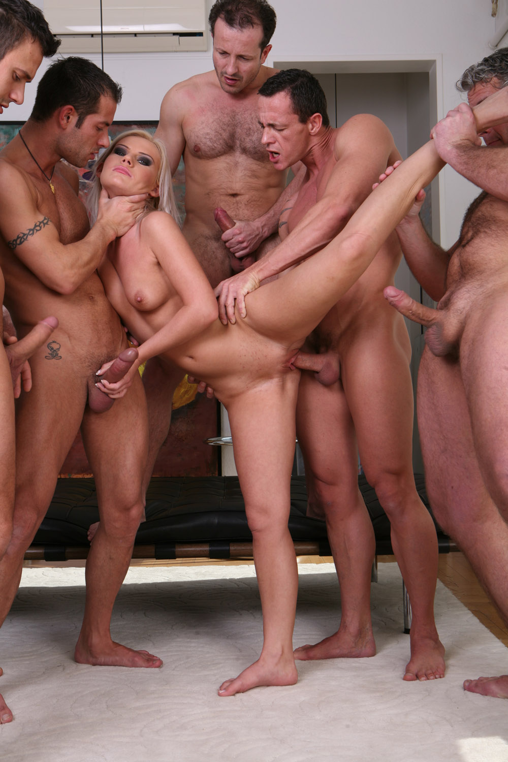 Gang bang naked woman pron scene