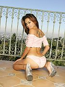 Hot brunette stripping on the balcony - Glamour Models Gone Bad