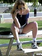 Summer Time Upskirts - on her cell and oblivious to upskirt spycam marauder! White panty upskirt crotch shots caught in city park!
