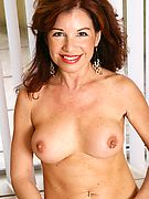 Hot mature showing off her delicious body