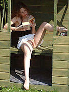Bare Pussy Upskirts - redhead reading outdoors in short skirt fondles her pussy!