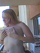 Naked on Her Neighbors Balcony - juicy jugs Julie bares big tits and big bubble butt outdoors on her neighbors balcony!