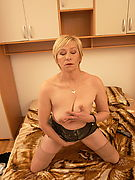 Naughty mature Eranka masturbating on her bed