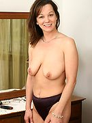 Sexy milf stripping nude in her bedroom